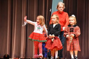 kids performing on holiday show stage