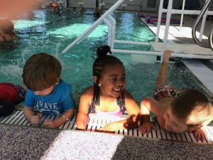 kids smiling in indoor pool